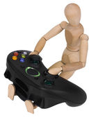 Artist's figure with a video game controller — Stockfoto