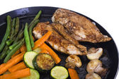 Chicken breasts with vegetable on a griddle — Stock Photo