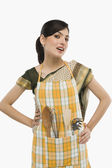 Housewife wearing an apron — Stock Photo