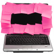 Adhesive notes attached on a laptop screen — Stock Photo