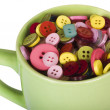 Close-up of a cup full of buttons — Stok fotoğraf