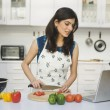 Woman cooking with the recipe on a laptop — Stock Photo #33007729