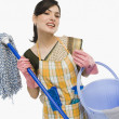 Woman holding a mop and a bucket — Stockfoto