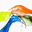 Splash of different color paints — Stock Photo