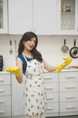 Woman standing in the kitchen — Stock Photo