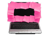 Adhesive notes attached on a laptop screen — 图库照片
