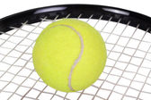 Close-up of a tennis racket with a tennis ball — Stock Photo