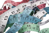 Close-up of tangled tape measures — Stock Photo