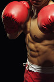 Male boxer in fighting stance — Stock Photo