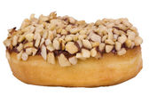 Close-up of a donut garnished with nuts — Stock Photo