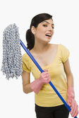 Woman holding a mop — Stock Photo