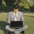 Businessman using a laptop — Stockfoto
