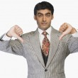 Businessman showing thumbs down — Stock Photo #33026343