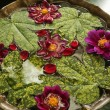 Stock Photo: Leaves with flowers in birdbath