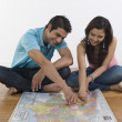 Couple examining map — Stock Photo #33027409