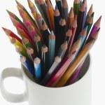 Colored pencils in a desk organizer — Stock Photo #33027493