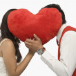 Couple romancing behind a heart shape — ストック写真
