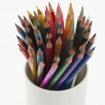 Colored pencils in a desk organizer — Stock Photo #33028611