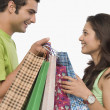 Couple carrying shopping bags — Stock Photo