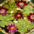 Leaves with flowers in a birdbath — Stock Photo #33029051