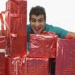 Man holding gift boxes and looking excited — Foto de Stock
