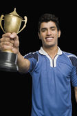 Soccer player holding a trophy — Photo