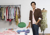 Tailor standing in a clothing store — Stock Photo