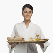 Woman holding a tray of products for aromatherapy — Stock Photo
