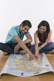 Couple examining a map — Stock Photo
