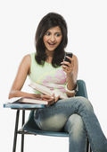 Student looking at a mobile phone — Stock Photo