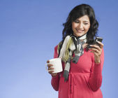 Woman text messaging on a mobile phone — Stock Photo