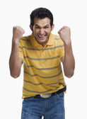 Man clenching his fists in excitement — Stock Photo