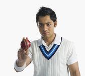 Cricket bowler holding a ball — Stock Photo