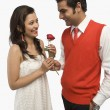 Man giving a rose to his girlfriend — Foto de Stock