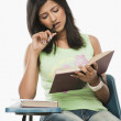 Student reading in a classroom — Stock Photo