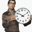 Stock Photo: Businessman showing a clock