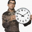 Businessman showing a clock — Stock Photo