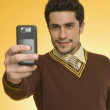 Businessman taking a picture from a mobile phone — Stock Photo