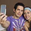Couple taking a picture of themselves with a mobile phone — Stock Photo