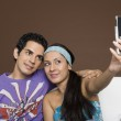 Couple taking a picture of themselves with a mobile phone — Stock Photo #33034253