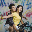 Couple riding a bicycle — Stock Photo #33034891