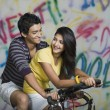 Couple riding a bicycle — Stock Photo #33035259