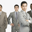 Four businessmen standing together — Stock Photo