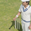 Stock Photo: Cricket player near wicket