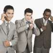 Three businessmen talking on mobile phones — Stock Photo #33036501