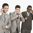 Three businessmen talking on mobile phones — Stock Photo