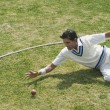 Cricket fielder diving to stop a ball — ストック写真