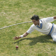 Cricket fielder diving to stop a ball — 图库照片