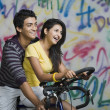 Couple riding a bicycle — Stock Photo #33037243
