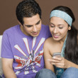 Couple reading a message on a mobile phone — Stock Photo #33037871